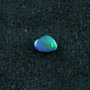 0.46 ct Black Opal gemstone 6.67 x 5.10 x 2.17 mm, pic1