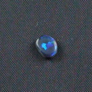 0.69 ct Black Opal gemstone 7.24 x 5.83 x 2.61 mm, pic2