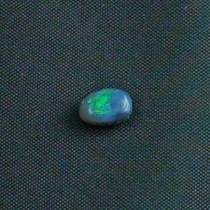 0.78 ct Black Opal gemstone 7.27 x 5.30 x 3.10 mm