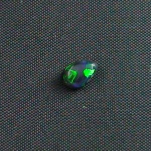 0.54 ct Black Opal gemstone 6.54 x 4.31 x 2.94 mm, pic3