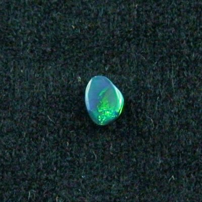 0.46 ct Black Opal gemstone 6.67 x 5.10 x 2.17 mm, pic2