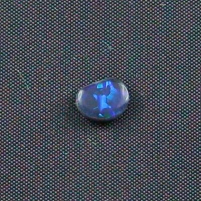 0.69 ct Black Opal gemstone 7.24 x 5.83 x 2.61 mm, pic3