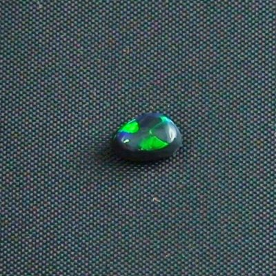 0.54 ct Black Opal gemstone 6.54 x 4.31 x 2.94 mm, pic1