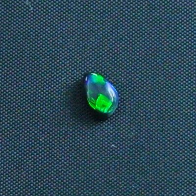 0.54 ct Black Opal gemstone 6.54 x 4.31 x 2.94 mm, pic2